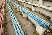 pic of grandstand  - Old dirty destroyed blue and red grandstands at old stadium - JPG