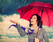 image of rainy season  - Smiling Woman with Umbrella over Autumn Rain Background - JPG