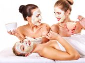 image of mask  - Young woman getting facial mask and gossip  - JPG