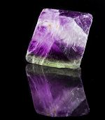 stock photo of peridot  - Fluorite Crystal Purple with reflection on black surface background  - JPG