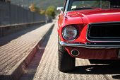 stock photo of muscle-car  - American muscle car convertible on the road cropped image - JPG
