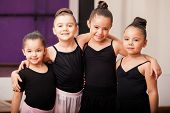 pic of leotard  - Pretty little girls having fun and hugging each other during a dance class - JPG