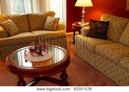 Interior of a cozy living room with sofas and coffee table