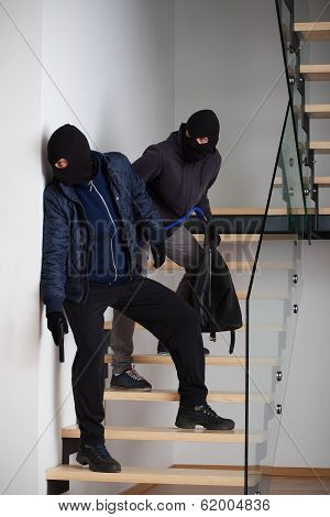 Two Criminals On Stairs
