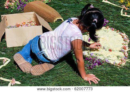Girl making Holy Week carpet, Antigua, Guatemala