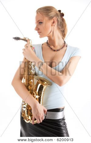 nice sexy blonde girl with saxophone standing with relaxing look