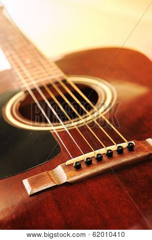 Musical instrument acoustic guitar close up in perspective