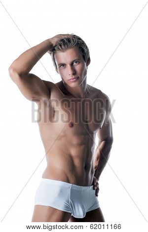 Shot of handsome muscular man advertises underwear