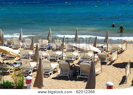 Sandy beach along Croisette promenade in Cannes France