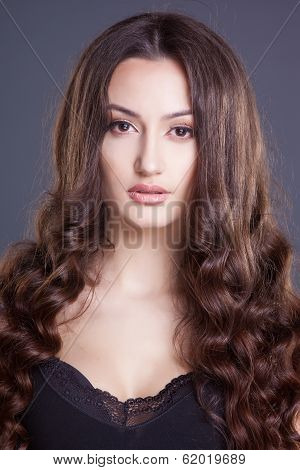 Beautiful hair, portrait of a young girl in studio