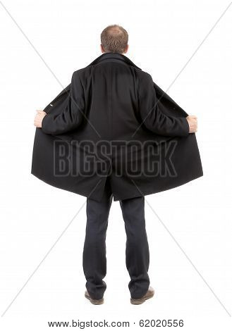 Back view of disclosed coat on man.