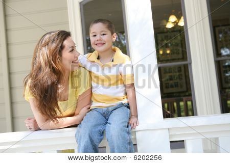 Boy And Mother At Home