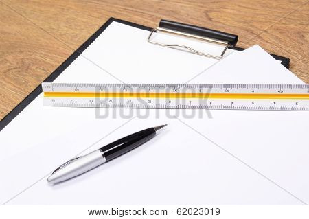 Clipboard, Pen And Straightedge On The Table