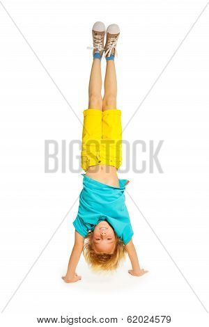 Blond boy standing on hands