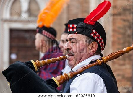 Portrait Of A Scottish Bagpiper