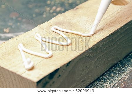 Putting Glue On A Piece Of Wood