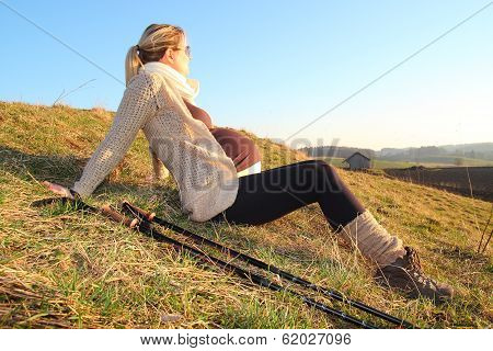 Pregnant Woman Heaving A Break During A Walk