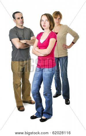 Teenage girl rolling her eyes in front of angry parents