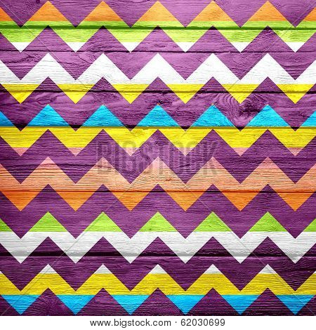Colorful chevron pattern on wood texture