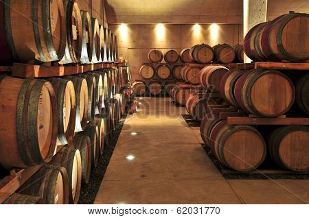 Stacked oak wine barrels in winery cellar