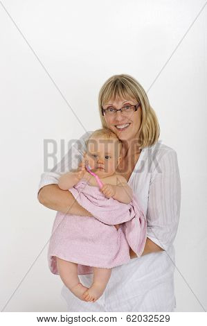grandmother holding her grandchild