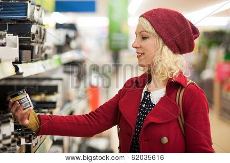 Woman checking food item in store