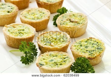 Plate of many mini bite size quiche appetizers