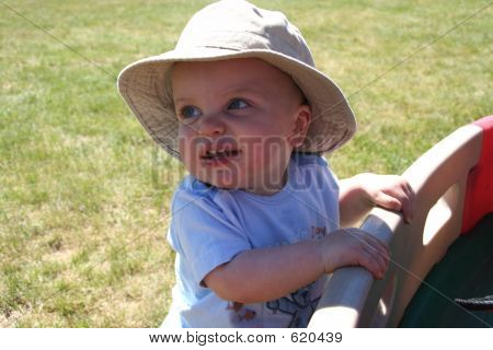 Little Boy Hanging Onto Wagon