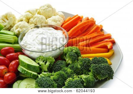 Platter of assorted fresh vegetables with dip