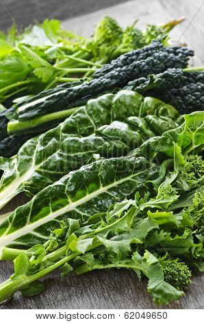 Dark green leafy fresh vegetables on cutting board