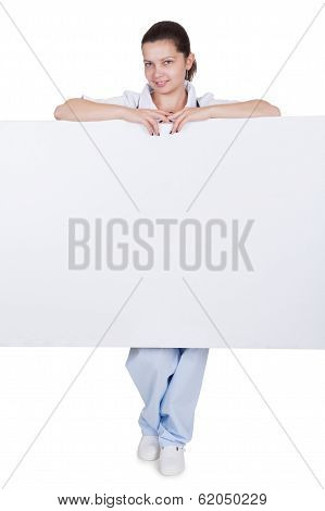 Doctor Or Nurse With Blank Signboard