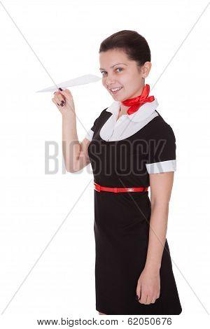 Beautiful Flight Attendant With Paper Aeroplane