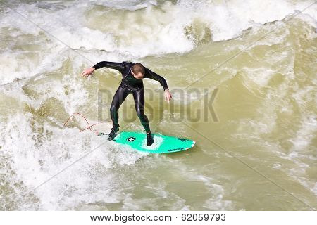Surfer Surfs At The Isar In Huge Waves