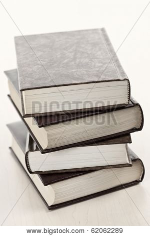 Stack of old hard cover leather bound books