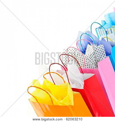 Many colorful shopping bags on white background