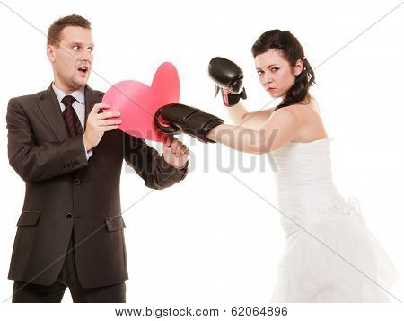 Wedding Couple. Bride Boxing Heart Of Groom.