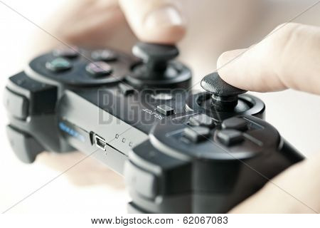 Male hands holding video game controller closeup