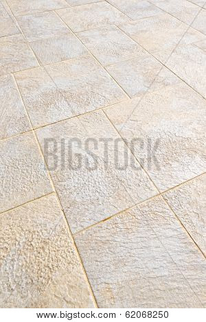Ceramic tile flooring close up as background