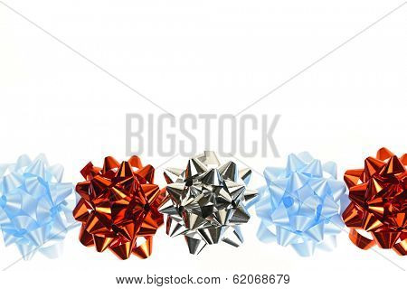 Row of multicolored gift wrapping bows isolated on white background