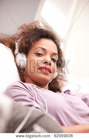 Beautiful Afroamerican Woman On A Sofa