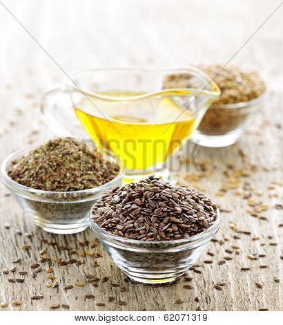 Bowls of whole and ground flax seed with linseed oil