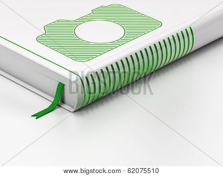 Vacation concept: closed book, Photo Camera on white background
