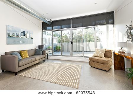 Living room with sliding glass door to balcony - artwork from photographer portfolio