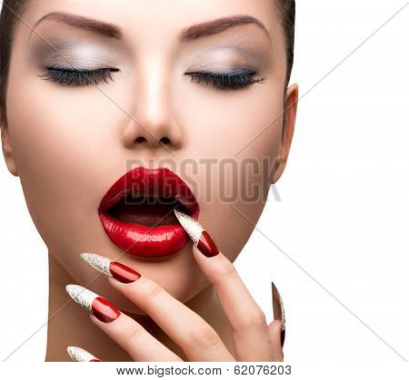 Fashion Beauty Sexy Model Girl. Manicure and Make-up. Nail art. Beautiful Woman With Red Nails and Lips. Luxury Makeup. Beautiful Girl Face and Hand close-up. Perfect Skin