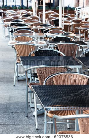 tables and chairs in modern cafe on the street