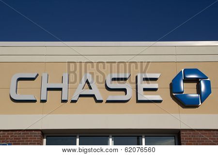 JACKSONVILLE, FL - MARCH 9, 2014: A Chase logo at a bank branch in Jacksonville. Chase bank is a US bank with more than 5,100 branches and 16,100 ATMs nationwide.