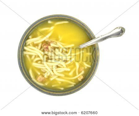 Chicken noodle soup with spoon