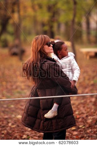 BUDAPEST, HUNGARY - NOV 5: Angelina Jolie and her child, Zahara enjoy an early evening visit to a park in Budapest, Hungary, on Friday, November 5, 2010.