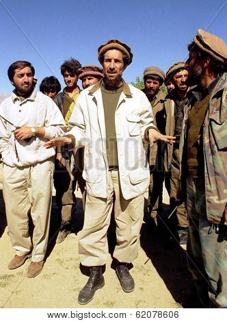 MAZAR, AFGHANISTAN - 03 OCTOBER: Anti-Taliban forces co-leader Shah Massood, seen here at center on October 3, 1996. giving directions to his troops during a battle for a mountain pass south of Mazar.