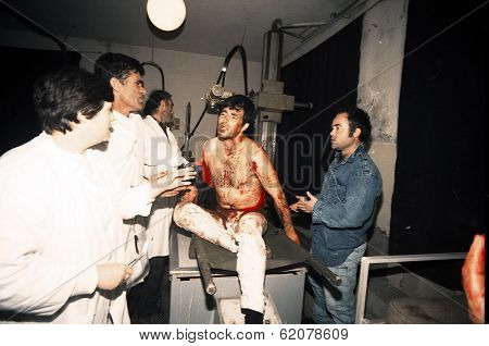 VLORE, ALBANIA - 10 APRIL: A man, bleeding from a gunshot wound, is brought to a hospital for first aid on April 10, 1997. Albania is in the midst of mass civil unrest unleashed by nationwide bank failures.